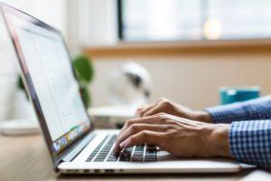 Online Presence - man typing on macbook laptop