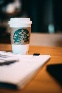 Branding - Starbucks cup on table with planner